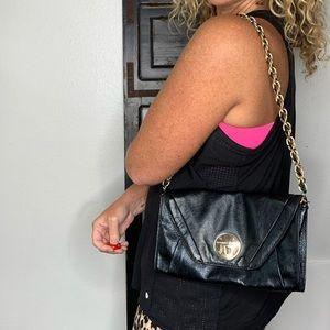 Elliott Lucca Black leather clutch shoulder bag